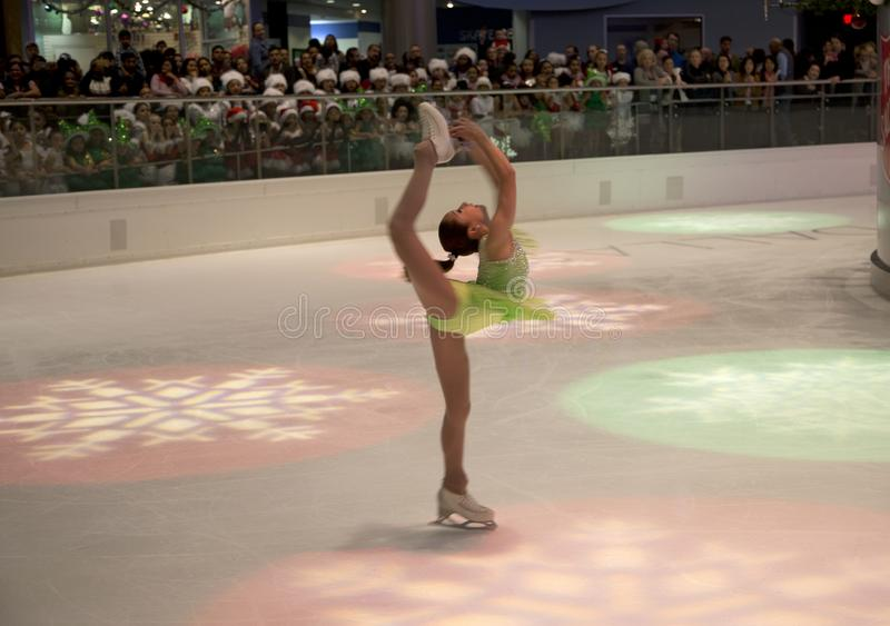 Figure skating show on holiday Galleria ice center. Figure skating perform movements, including complicated lifts on holiday Galleria ice center, Dallas TX USA stock photos
