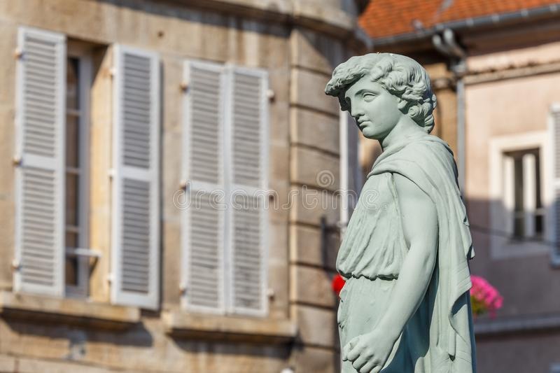 Figure on the street of historic Avallon town, France. AVALLON / FRANCE - JULY 2015: Figure on the street of historic Avallon town, France royalty free stock images