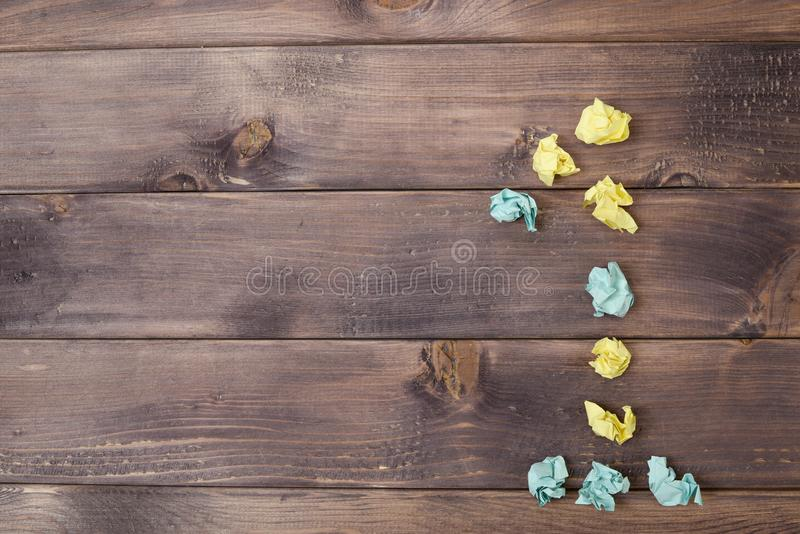 Figure 1 on a table. Crumpled pieces of paper in the form of balls, forms figure 1 on a dark wooden table. top view stock photos