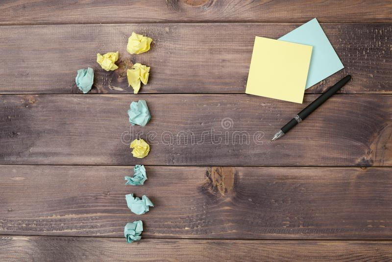 Figure 1 on a table. Crumpled pieces of paper in the form of balls, forms figure 1 on a dark wooden table. top view royalty free stock images