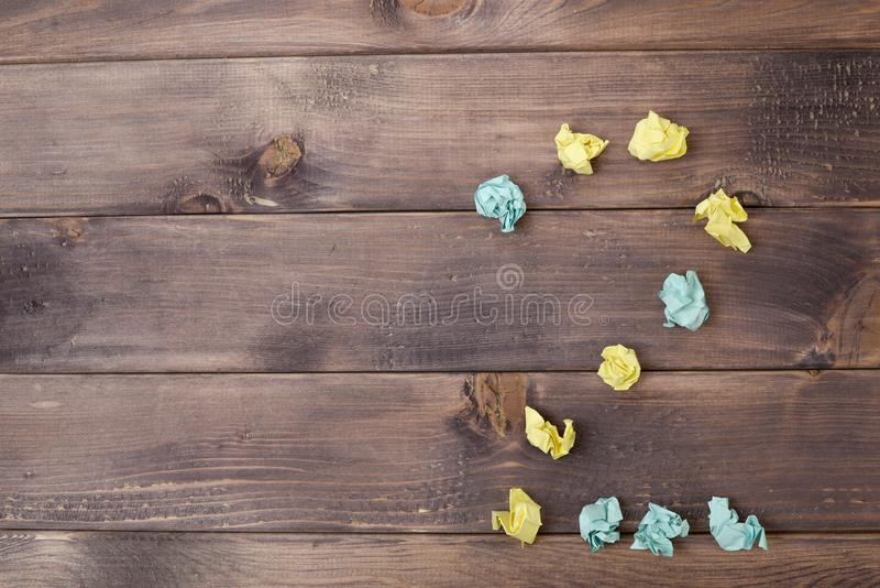 Figure 2 on a table. Crumpled pieces of paper in the form of balls, forms figure 2 on a dark wooden table. top view royalty free stock photos