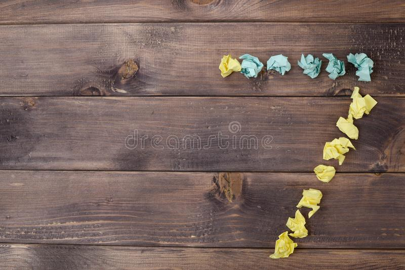 Figure 7 on a table. Crumpled pieces of paper in the form of balls, forms figure 7 on a dark wooden table. top view royalty free stock images