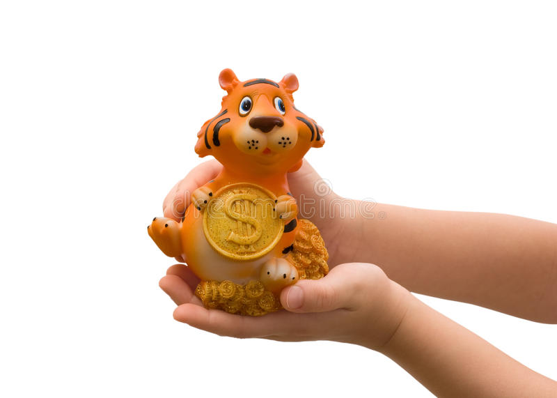 Figure of a tiger in children's hands. royalty free stock photos
