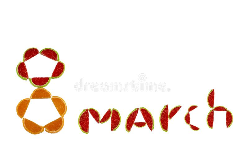 Figure 8 and the word March of fruit slices of marmalade on a white isolated background royalty free stock photography