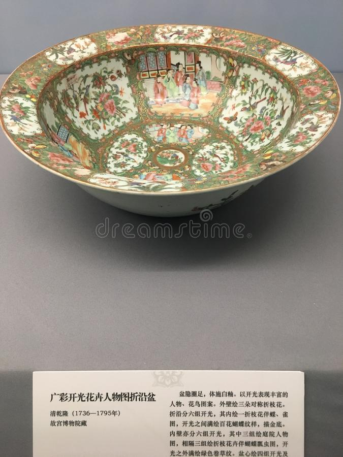The figures of Canton glazed porcelain flowers are folded along the basin. Qing qianlong royalty free stock image