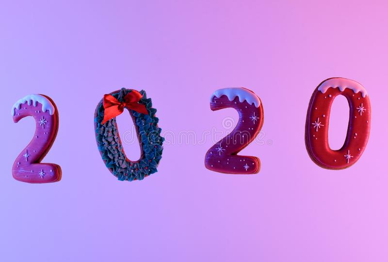 Figures 2020 on a colored background. Fragrant gingerbread cookies in the form of numbers. Figures 2020 on a color neon background. Fragrant gingerbread cookies stock photos