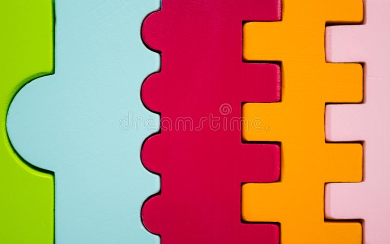 The figures of different colors and forms bonded together stock photography
