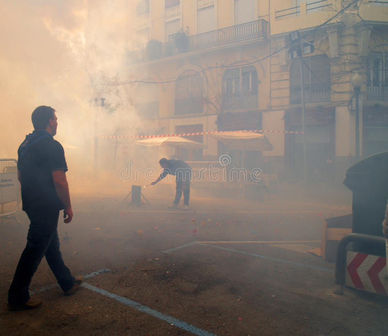 Figures draped in smoke during the annual festival of Las Fallas royalty free stock photo