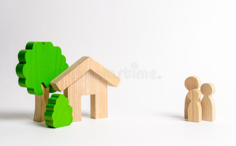 Figures of the family and house on a white background. real estate, your own home. Affordable housing on credit or mortgage. Renovation and construction stock photography