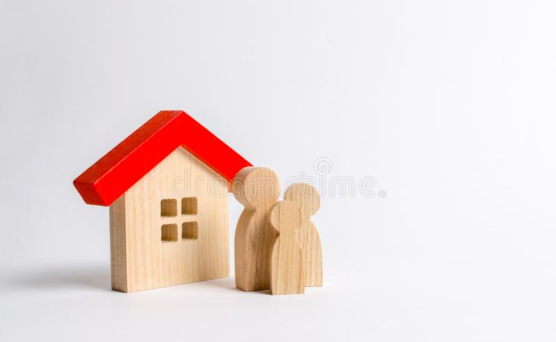 Figures of the family and house on a white background. real estate, your own home. Buying or selling. Affordable housing on credit. Or mortgage. Renovation and stock image