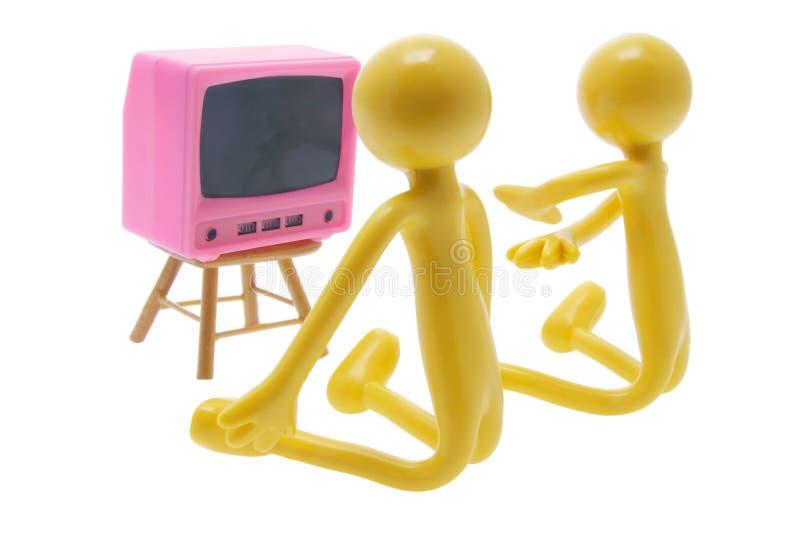 Figures miniatures avec le jouet TV photo stock