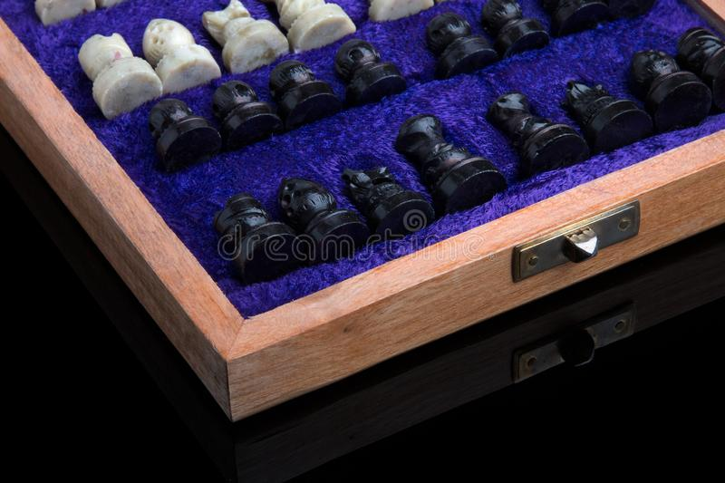 Figures from a natural stone, lying in a case. A complete chess game. Chess pieces lying in a box board collected case figures stone game success leadership royalty free stock image