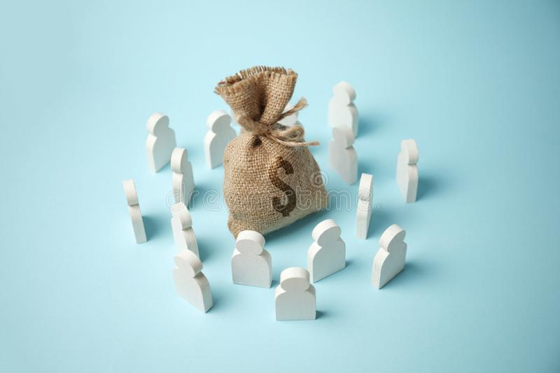 Figures of people are drawn to bag of money and wealth.  stock images