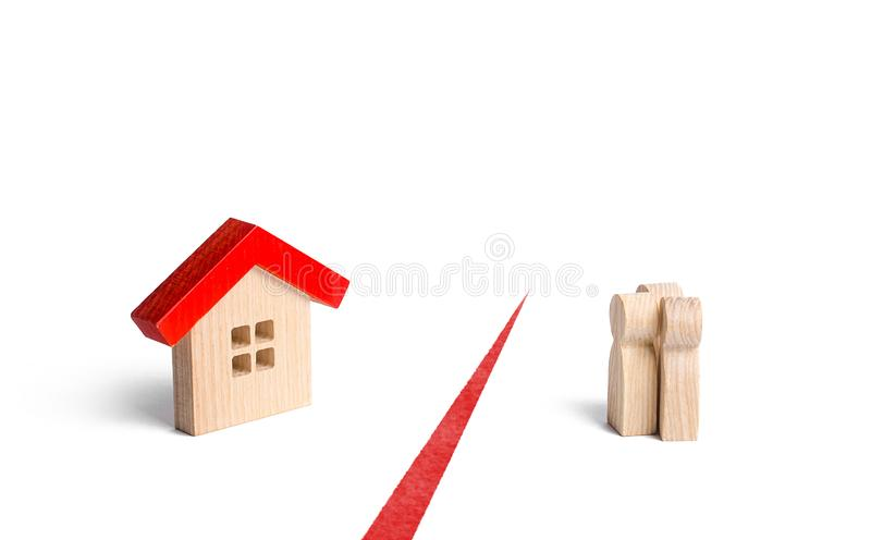 The figures of people and the house are separated by a red line. Inaccessibility and high housing prices. Social programs. And soft mortgages for young families stock photos