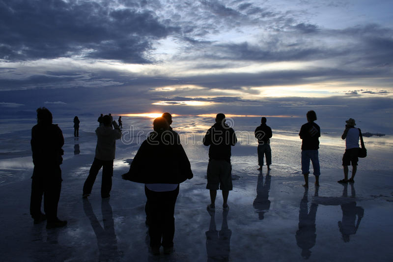 Figures at sunset on the Bolivian saltflats stock images