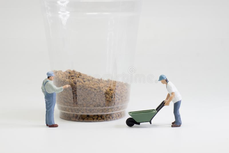 the figures working on coffee macro photo royalty free stock photography