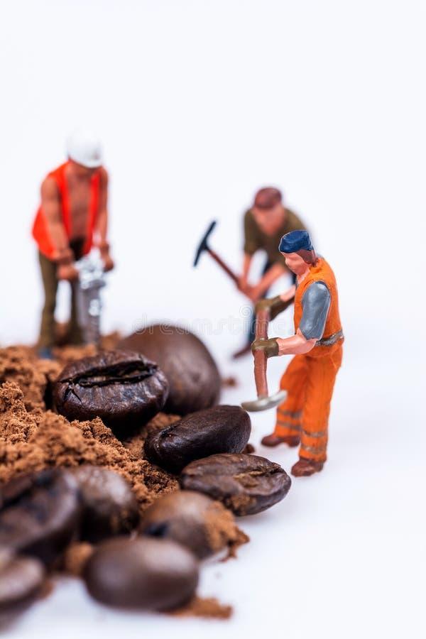 Figures working on coffee stock photography