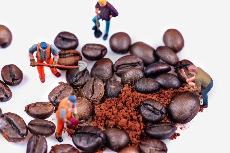 Figures working on coffee stock image