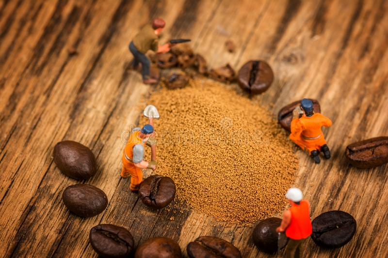 Figures working on coffee stock images