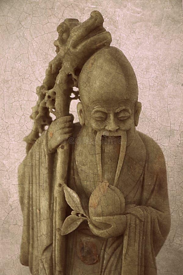 Figurilla antigua del monje de la esteatita del vintage que talla el fondo abstracto de la textura de la superficie del modelo de fotos de archivo libres de regalías