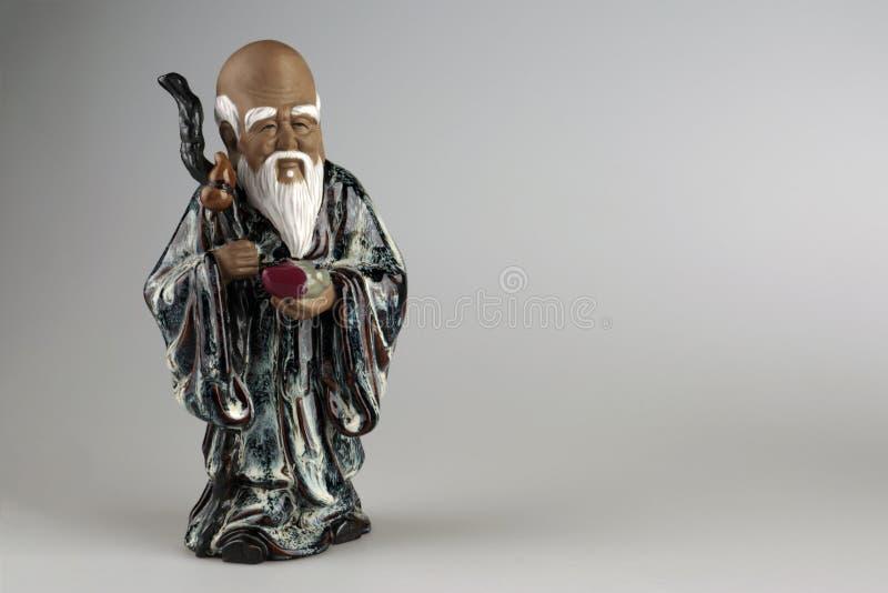 Figurilla china con la imagen del sabio imagenes de archivo