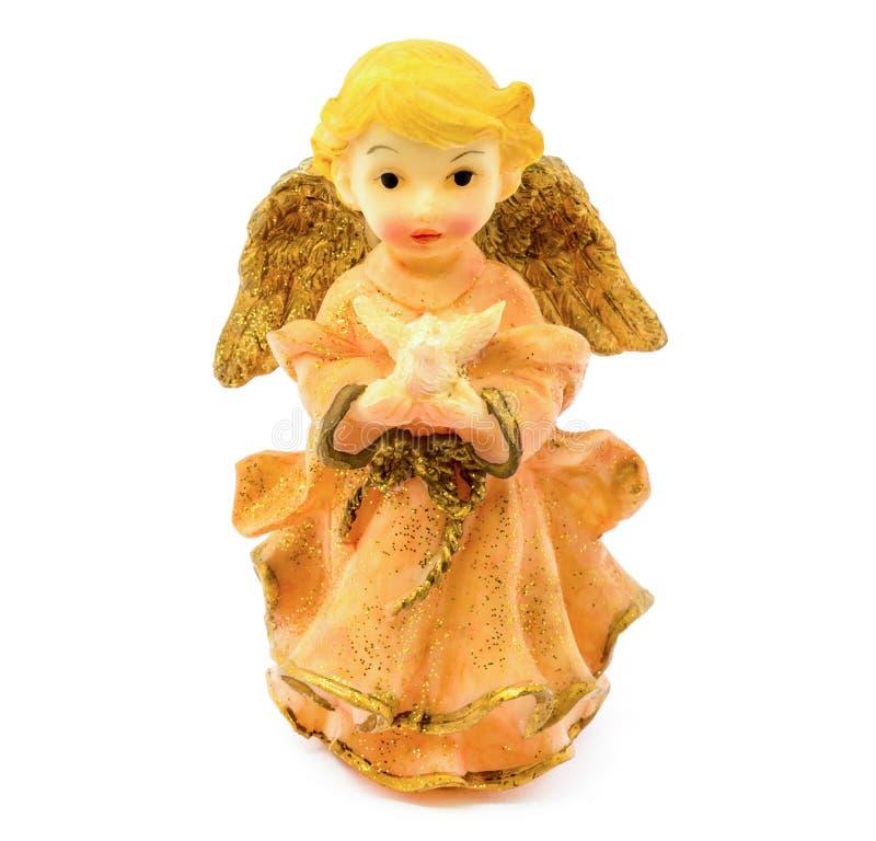 Figurilla del ángel de la porcelana con la paloma aislada en el fondo blanco fotografía de archivo libre de regalías