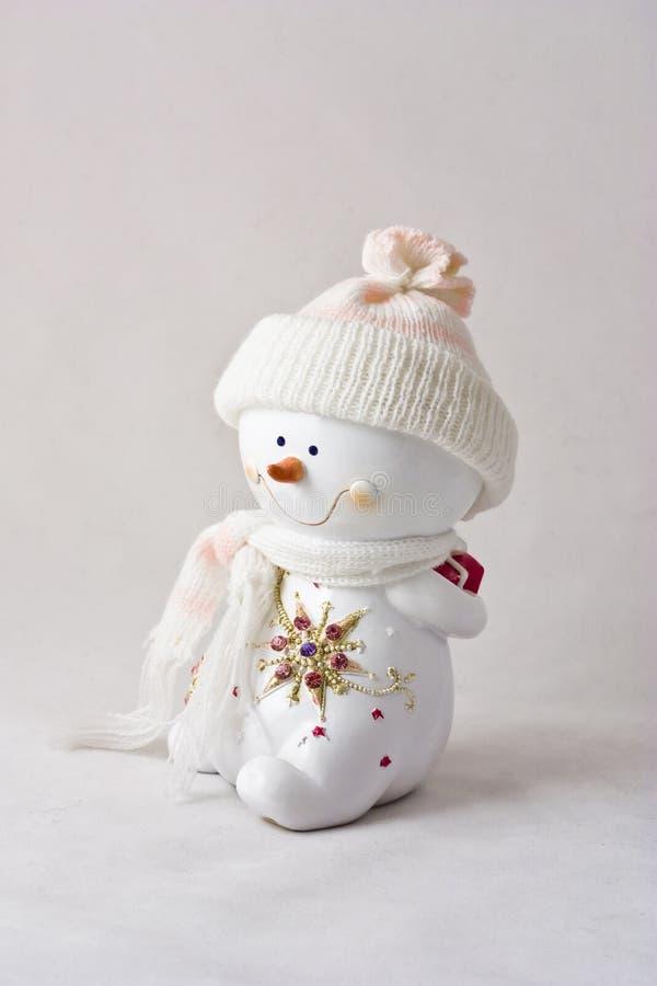 Figurilla del muñeco de nieve imagenes de archivo