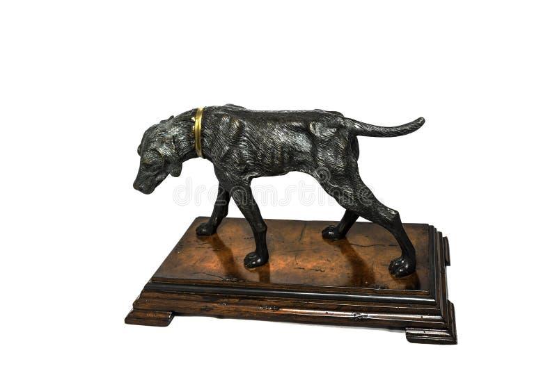 Figurilla del perro en el fondo blanco fotografía de archivo libre de regalías