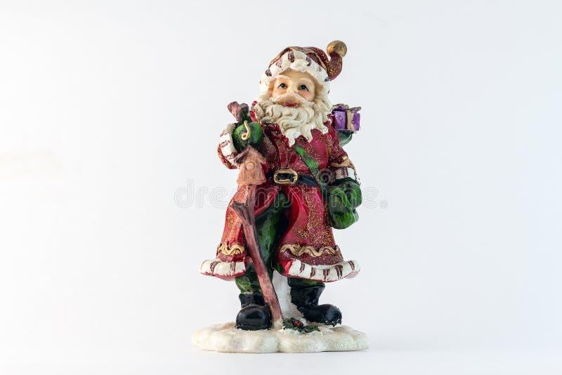Figurina di Santa Claus isolata su fondo bianco fotografie stock