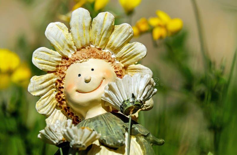 Солнцецвет с Figurine стороны стоковое фото rf