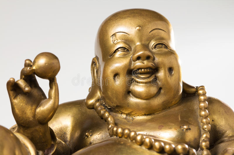 Figurine Cheerful Hotei. Chinese God of Wealth royalty free stock photography
