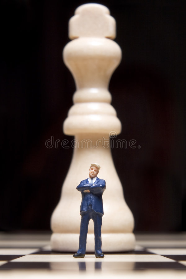 Figurine and chess stock images