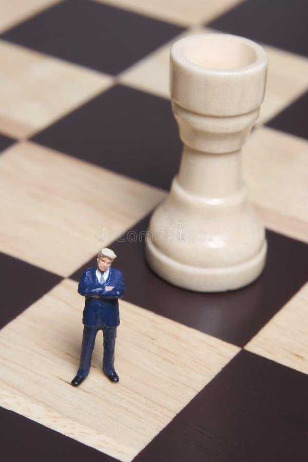 Figurine and chess stock photos