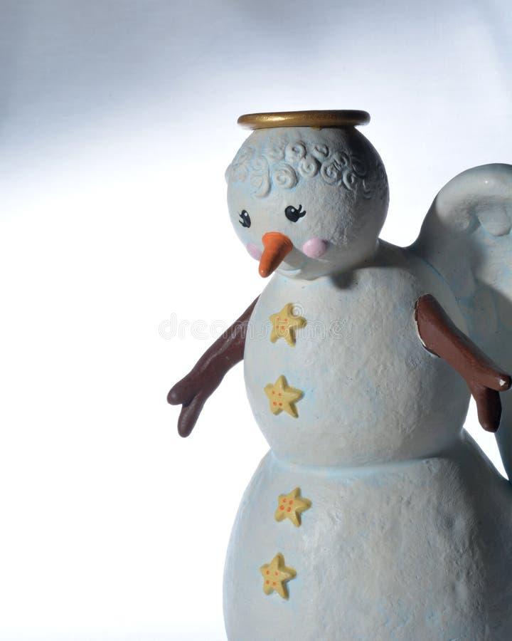 Figurine d'ange de bonhomme de neige photos stock