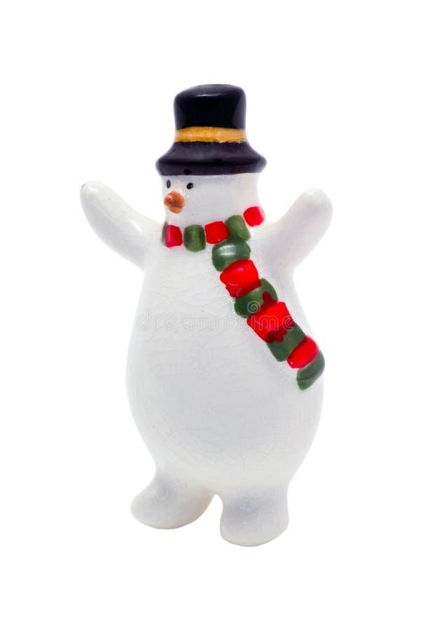 Figurine d'isolement de Noël : Givré le bonhomme de neige images stock