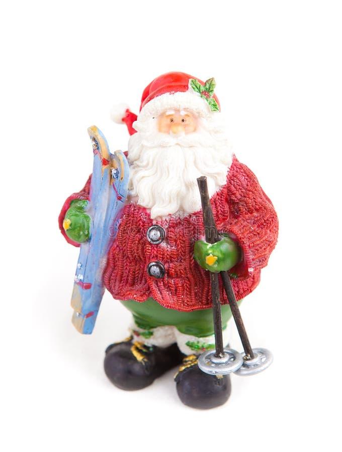 Figurine de Papai Noel com esquis à disposicão fotos de stock royalty free