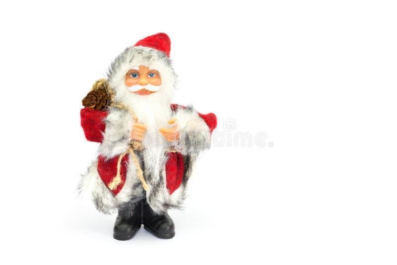 Figurine de Santa Claus d'isolement sur le fond blanc image stock