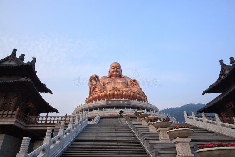 Figurine di risata del Buddha fotografie stock