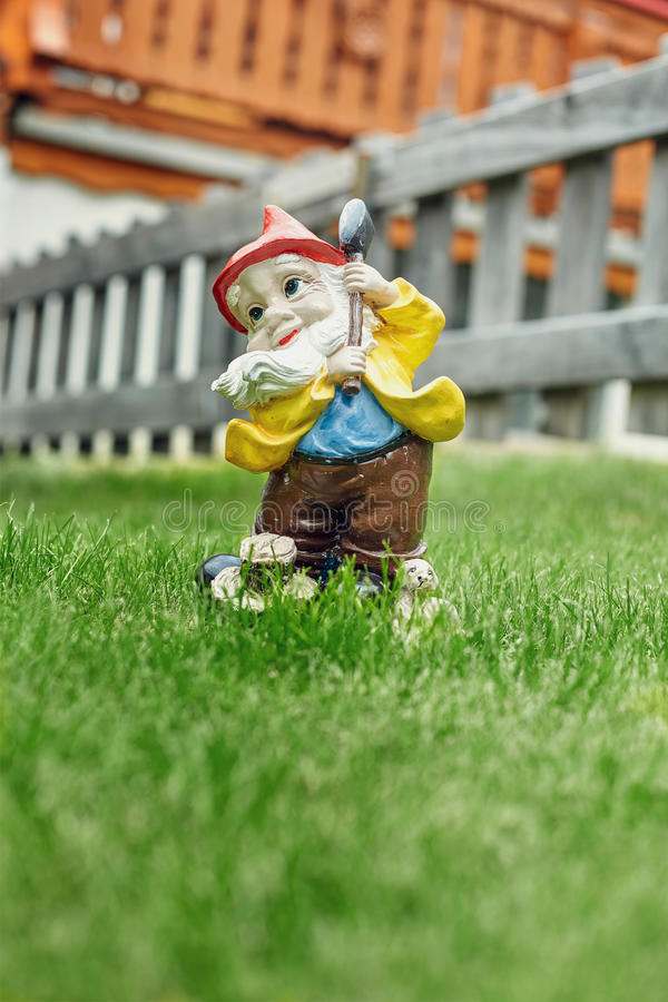 Figurine of a dwarf on the grass in the yard. In Zermatt town, Switzerland royalty free stock images