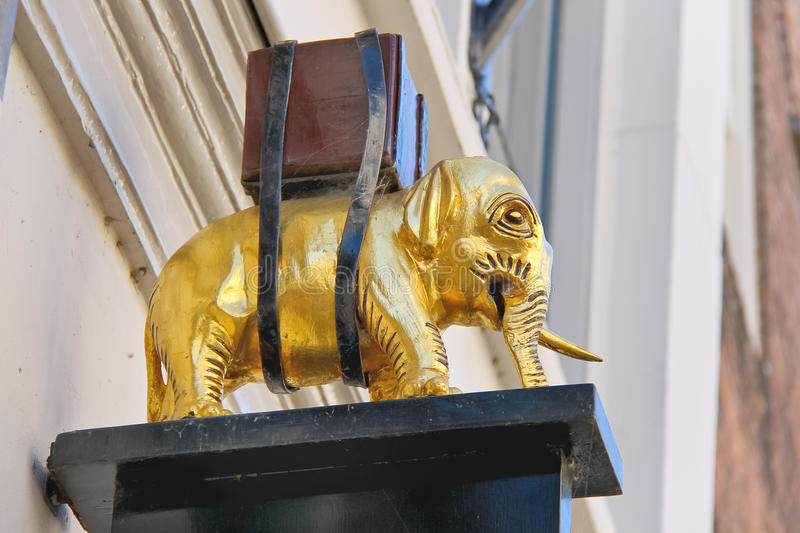 Figurine of an elephant on the building wall in Dordrecht, royalty free stock photo