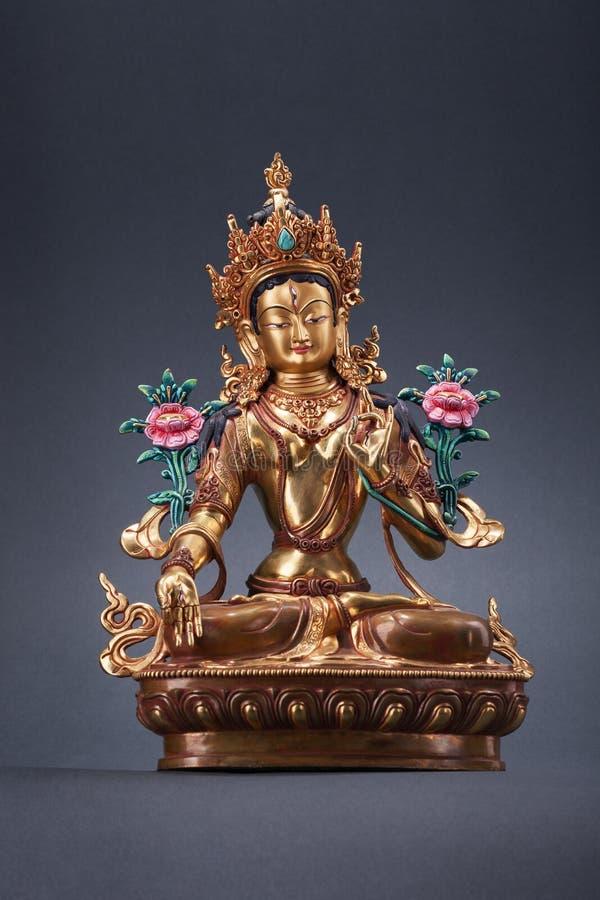 Figurine en bronze d'un Tara vert - la grande femme d'un bodkhisat images stock