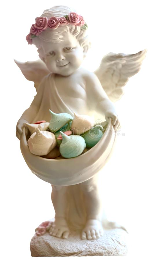 Figurine isolate. An angel with wings with a wreath on his head holds a bowl royalty free stock images