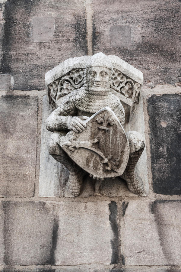 Figurine of a knight on the wall of St. Lorenz (St. Lawrence) c royalty free stock photos