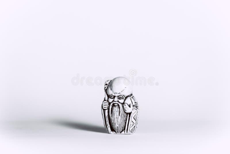 Figurine le moine sur un fond blanc images stock