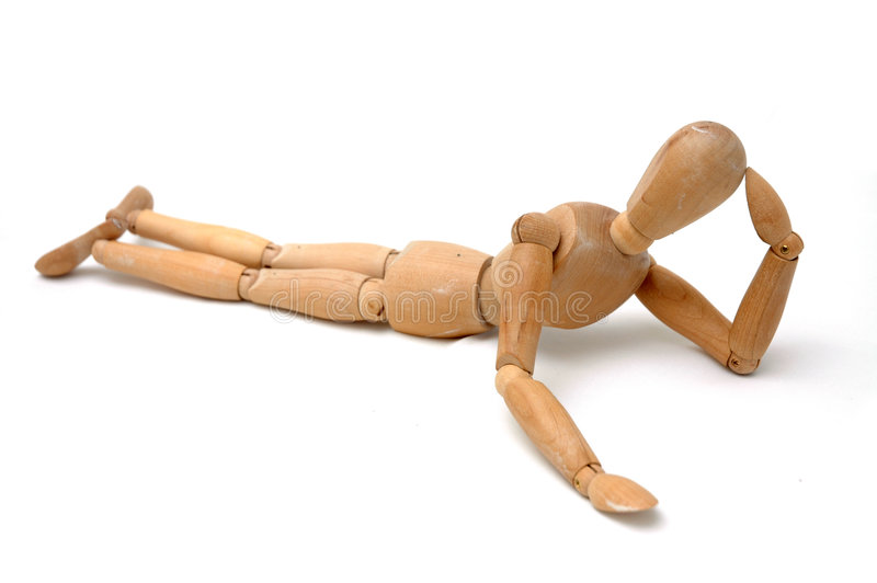 Figurine - Lying and Thinking stock photos