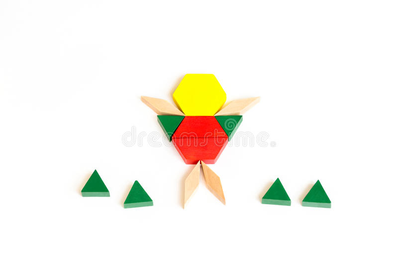 Figurine of man from colored wooden cubes blocks. White background. stock images