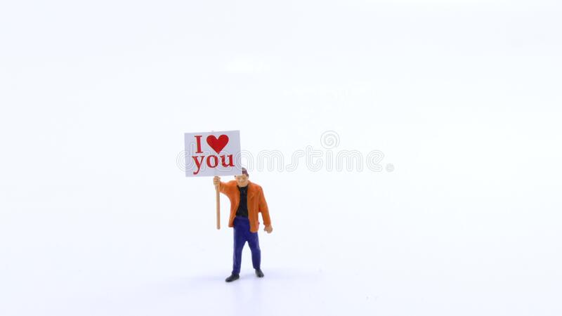 Man holding I love you signboard royalty free stock photos