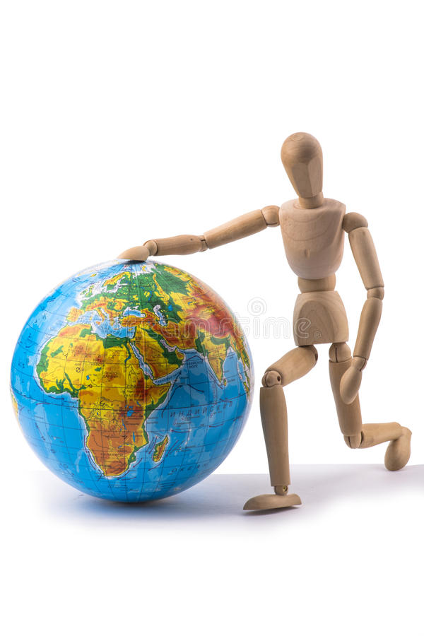 Figurine of a man running and rolls the globe next to him stock images