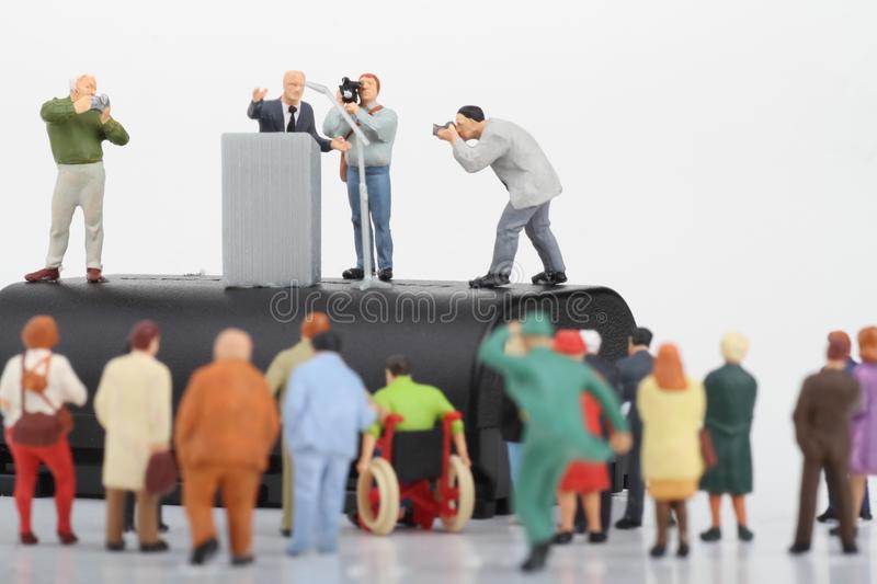Figurine of a politician speaking to the people. Miniature figurine of a politician speaking to the crowd on an election rally stock image