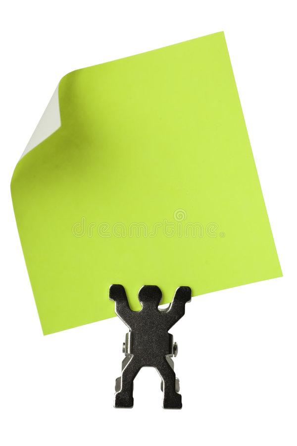 Figurine que prende uma parte de papel amarelo em branco foto de stock
